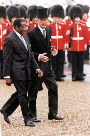 1994Mugabe inspects the troops with the Duke of Edinburgh during his official state visit to the UK in