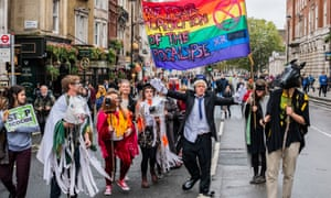 A protester at the Extinction Rebellion demonstration in Whitehall on Monday mocks the prime minister, Boris Johnson