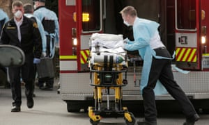 A medic prepares a stretcher to transfer a patient into an ambulance at the Life Care Center of Kirkland, the long-term care facility linked to several confirmed coronavirus cases in the state, in Kirkland, Washington, March 5, 2020.
