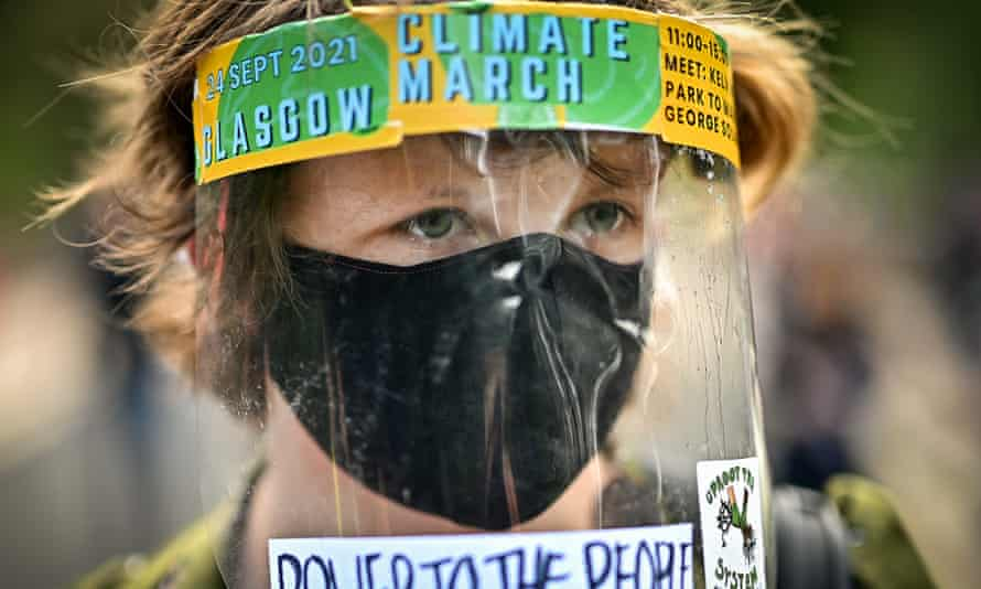 A boy at at climate protest in Glasgow