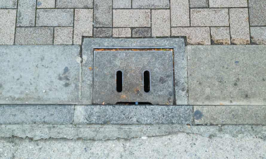 A concrete pipe lid in Tokyo, Japan, that looks like a face