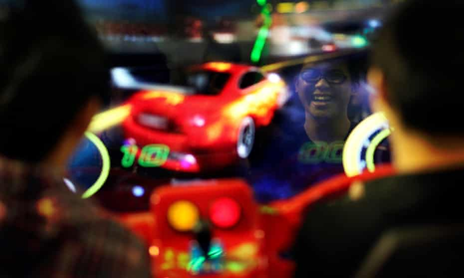 Two boys try their skills on a car racing arcade game during the opening of the GTI, Game Time International Expo, in Taipei in 2011.