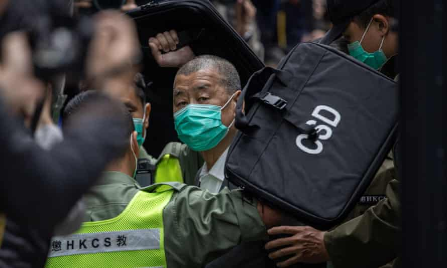 Hong Kong media mogul Jimmy Lai is escorted out of a Correctional Services Department vehicle and into the Court of Final Appeal on Tuesday.