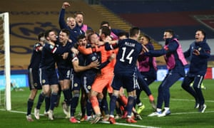 Scotland players celebrate after winning the match.