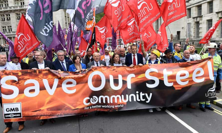 Steel workers and union representatives march on Wednesday to call for responsible sale of Tata Steel's UK business.