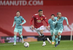 Manchester United's Mason Greenwood runs with the ball.