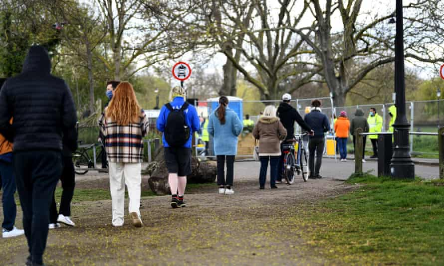 People queue at a coronavirus surge testing site after cases of the South African variant were confirmed in south London.
