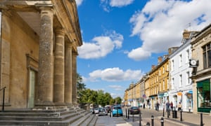 Centre of the Cotswold market town of Chipping Norton with the Town Hall to the left, Oxfordshire, England, UK