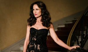 Andie MacDowell on a staircase in a black dress
