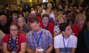 Attendees lower their heads for a prayer at the opening ceremonies at the 2018 Values Voters Summit in Washington.