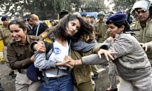 Police detain a student during a protest demanding the resignation of the Hyderabad University vice-chancellor over the suicide of a Dalit scholar Rohit Vemula.