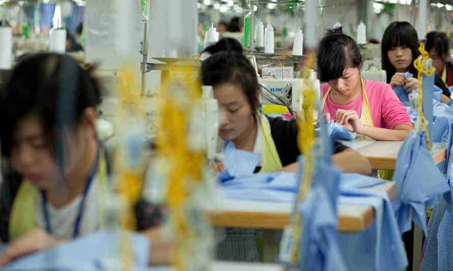 Workers sew shirts at the Lever Style factory in Shenzhen, Guangdong province, China.