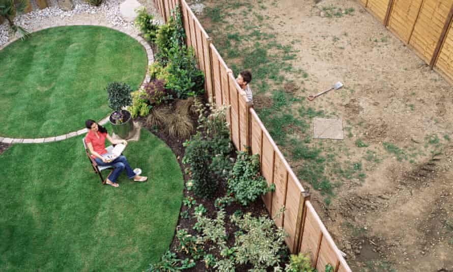 Neighbours talking over the garden fence