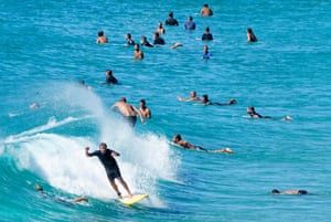Surfers carry on during the coronavirus lockdown. Three Gold Coast beaches – the Spit, Coolangatta and Surfers Paradise – have been closed after visitors ignored social distancing rules