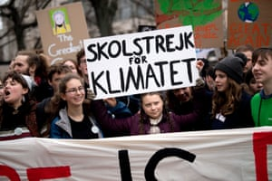 The Swedish climate activist Greta Thunberg holds up a sign in Berlin, Germany in March