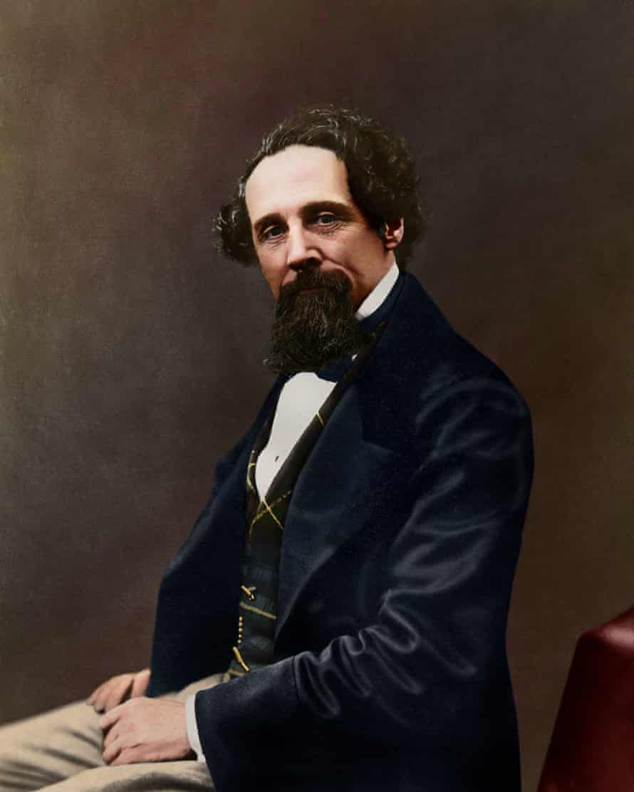 A colourised photograph, originally black and white, of a 47-year-old Dickens.