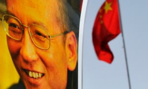 An image of Liu Xiabo next to a Chinese flag
