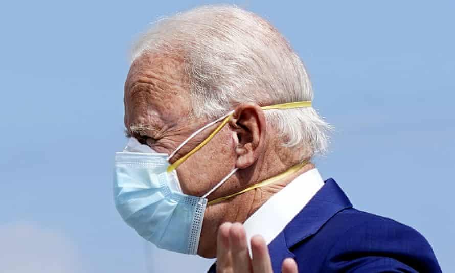 Joe Biden wearing two masks.
