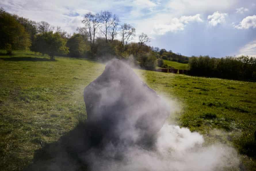 A smoke machine billows smoke behind a stone at the Stone Circle.