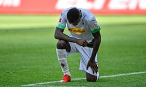 Marcus Thuram kneels after his goal on Sunday