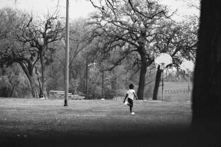 Park Day. A young girl runs to her family during a park outing. At Joppa Preserve, they gather to barbecue.