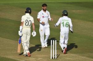 Yasir Shah celebrates with wicketkeeper Mohammad Rizwan as Ollie Pope walks.