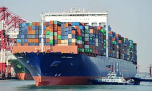 A US cargo ship berths at a port in Qingdao in China's eastern Shandong province