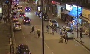 CCTV image of the attack on Alan, in front wearing a blue top riding his bike.