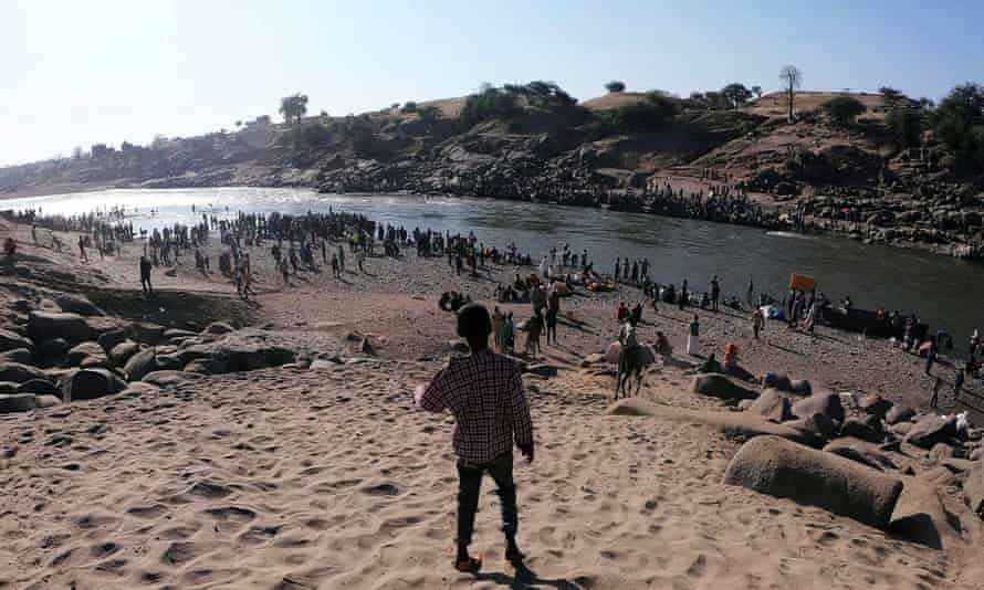 Ethiopians at the Tekeze River, also known as the Setit River, that runs between the Tigray region in the country and neighbouring Sudan