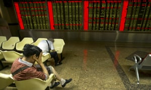 An Chinese investor reacts to stock market falls.