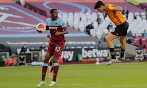 Wolves' Raul Jimenez heads in the opening goal of the game.