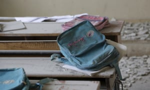 Schoolbags are abandoned on desks at a school damaged by a Russian airstrike in Injara.