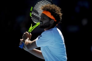 Jo-Wilfried Tsonga of France hits a backhand.