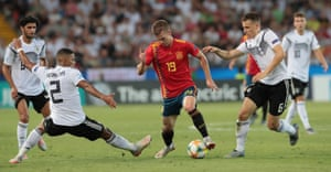 Dani Olmo (C) of Spain in possession.