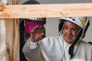Camerino, Italy. Pope Francis, wearing a safety helmet, enters the cathedral during a visit to areas affected by the earthquake on 24 August 2016