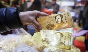 Fake 100 yuan 'gold' notes seized in Shenzhen city, Guangdong province, China.