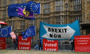 The EU flags of anti-Brexit activists fly as pro-Brexit activists stand with their placards and demonstrate near the Houses of Parliament in central London on 3 September.
