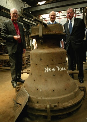 The then archbishop of Canterbury, George Carey, with lord mayor of London Michael Oliver and US ambassador to Britain William Farish with a bell commissioned to commemorate the 9/11 attacks that was shipped to New York to stand in the grounds of Wall Street's Trinity Church.