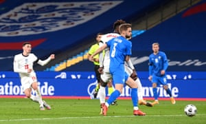 England's Phil Foden (left) scores his side's third goal.
