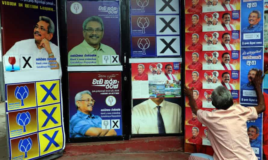 A supporter hangs posters of SLPP presidential candidate and former defence secretary Gotabhaya Rajapaksa.