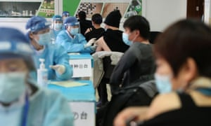 Medical workers administering the Covid-19 vaccine at a makeshift vaccination site in Beijing last week.