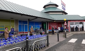 People queue outside a Tesco store in Dundee