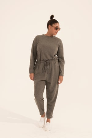 grey loose fitting jumpsuit, white trainers, brown sunglasses