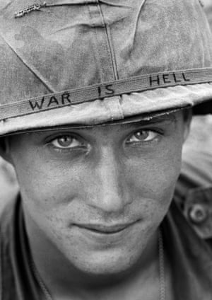 An unidentified American soldier wears a hand-lettered slogan on his helmet, June 1965. The soldier was serving with the 173rd Airborne Brigade on defense duty at the Phuoc Vinh airfield