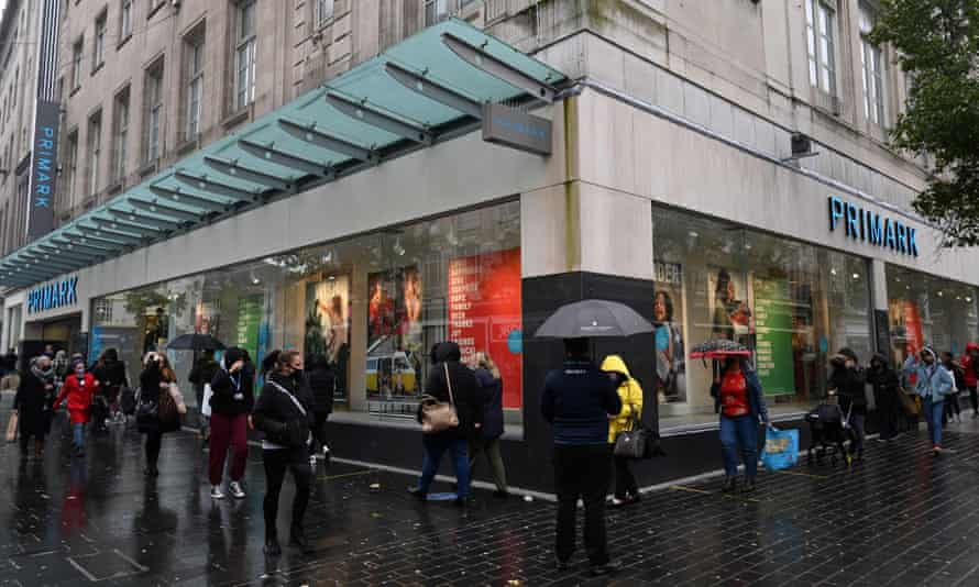Shoppers queue to enter a Primark store in Liverpool on Wednesday.
