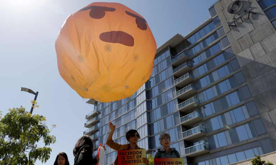 Protesters hold an inflatable angry emoji outside of Facebook's annual shareholder meeting in Palo Alto, California.