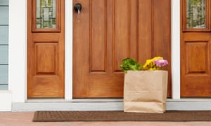 A grocery bag placed on someone's front doorstep. As the novel coronavirus pandemic intensifies, people are using the Internet to help vulnerable people in their neighbourhoods.