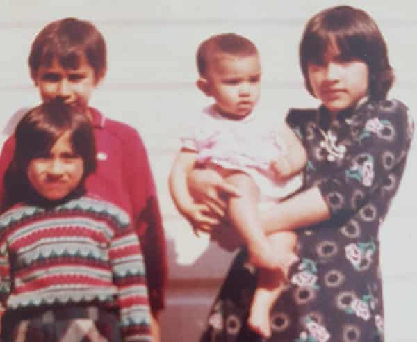 Saima Mir holding her sister Javaria, with brother Zafar and sister Fozia in 1984