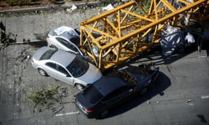 Part of a crane lies on top of cars in Mercer Street, Seattle.