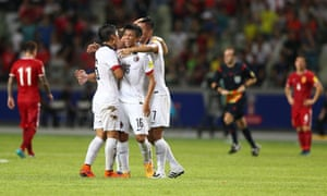 Hong Kong players celebrate after they held China to a 0-0 draw in 2018 World Cup qualifying.